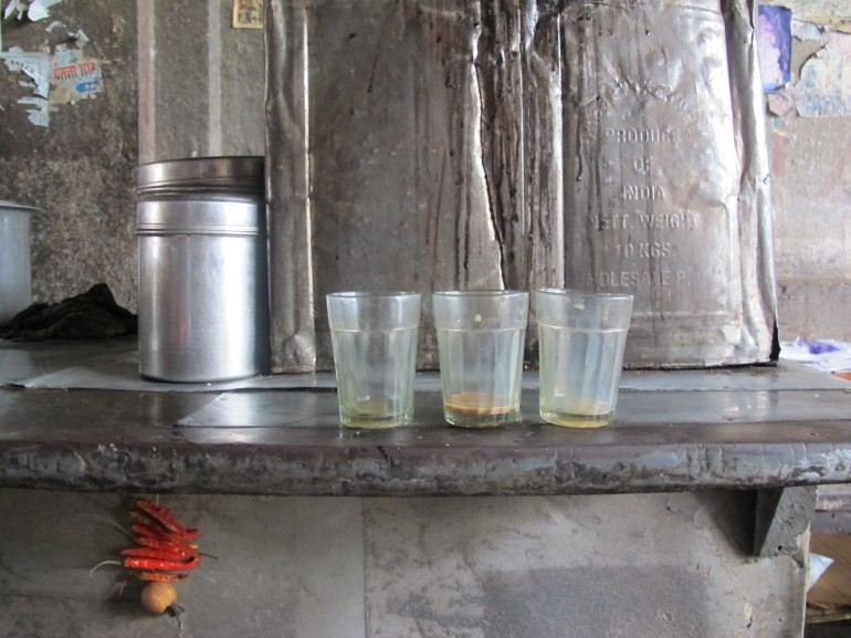 Three cups of tea. A delicious break, enjoyed in the cool air beneath the Dhobi Ghat bridge.
